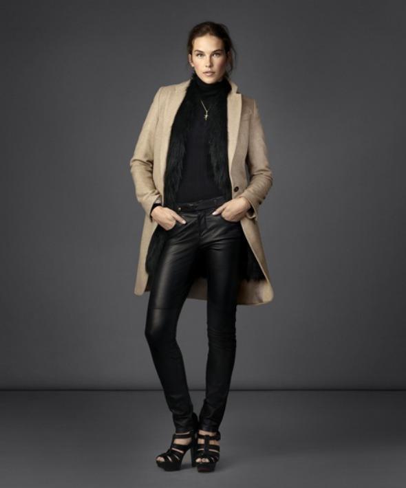 black turtleneck with leather pants