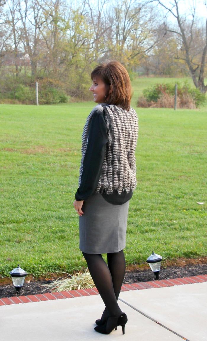 fur vest and black heel
