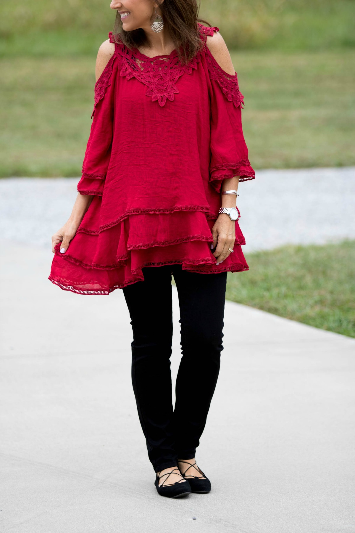 Cyndi is wearing a cold shoulder lace tunic for fall