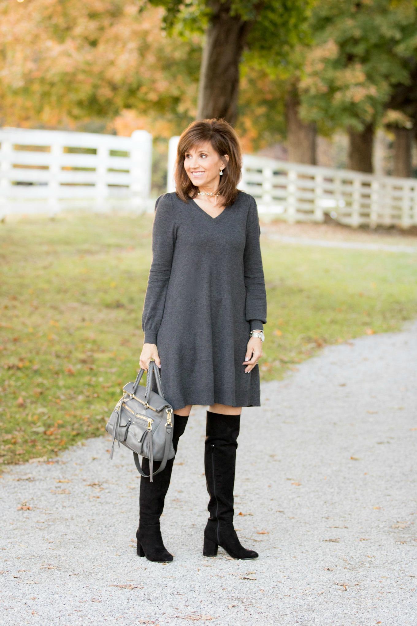 Fashion blogger Cyndi Spivey styling a sweater dress from Loft.