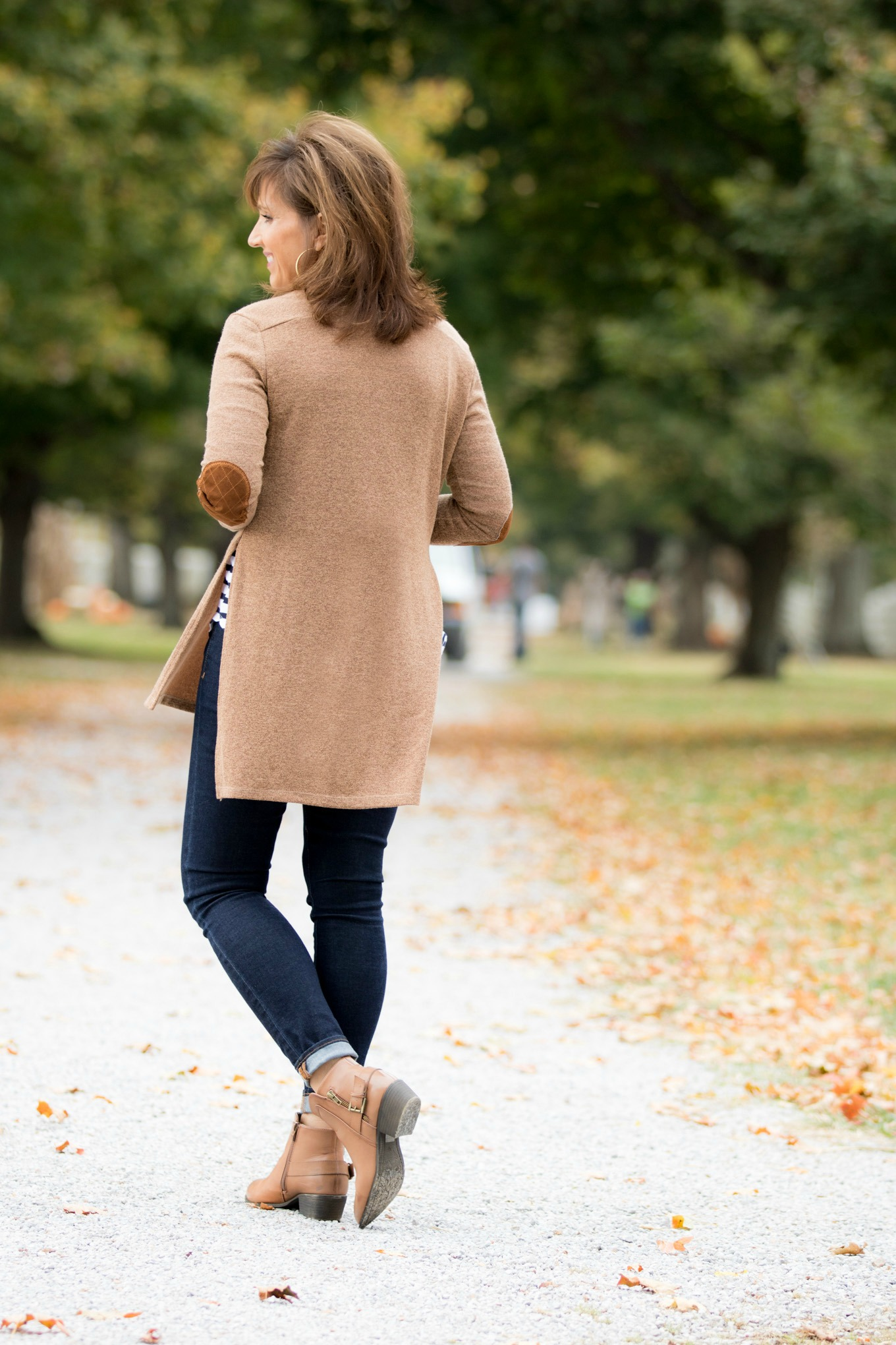 Fashion blogger, Cyndi Spivey, styling a cardigan with booties.