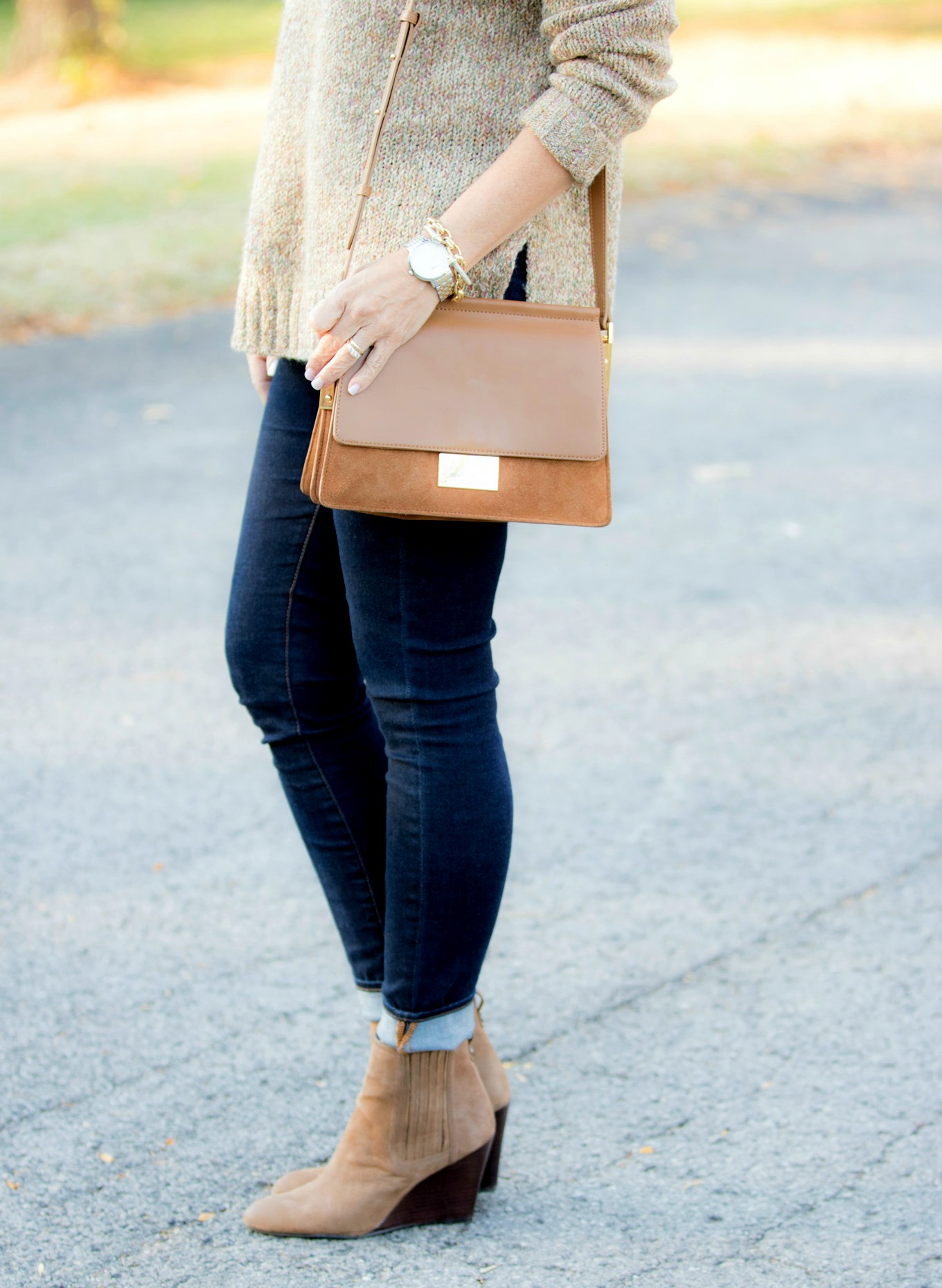 Fashion blogger Cyndi Spivey styling a casual fall outfit from Nordstrom for women over 40.