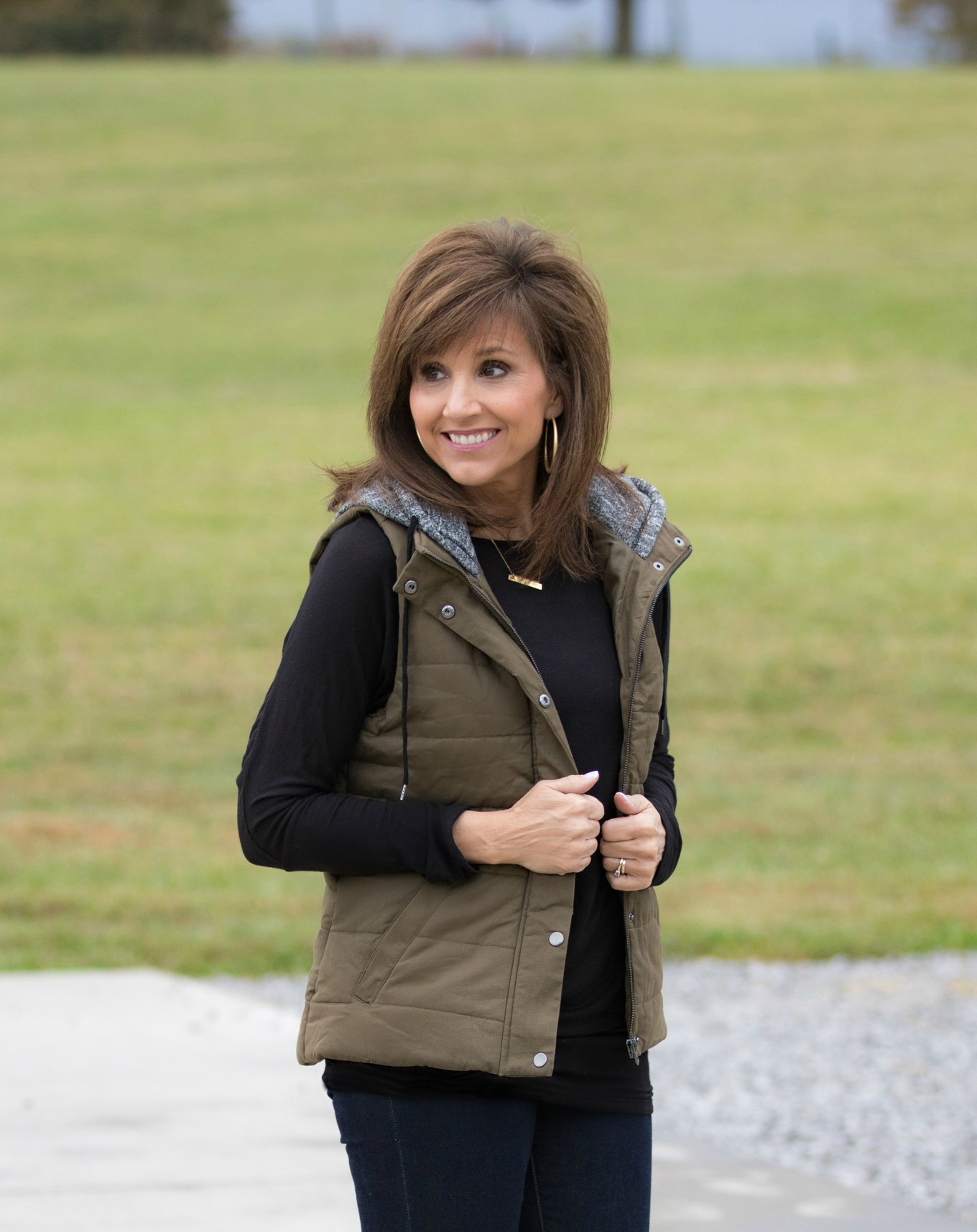 Fashion blogger, Cyndi Spivey, styling a hooded vest for fall.