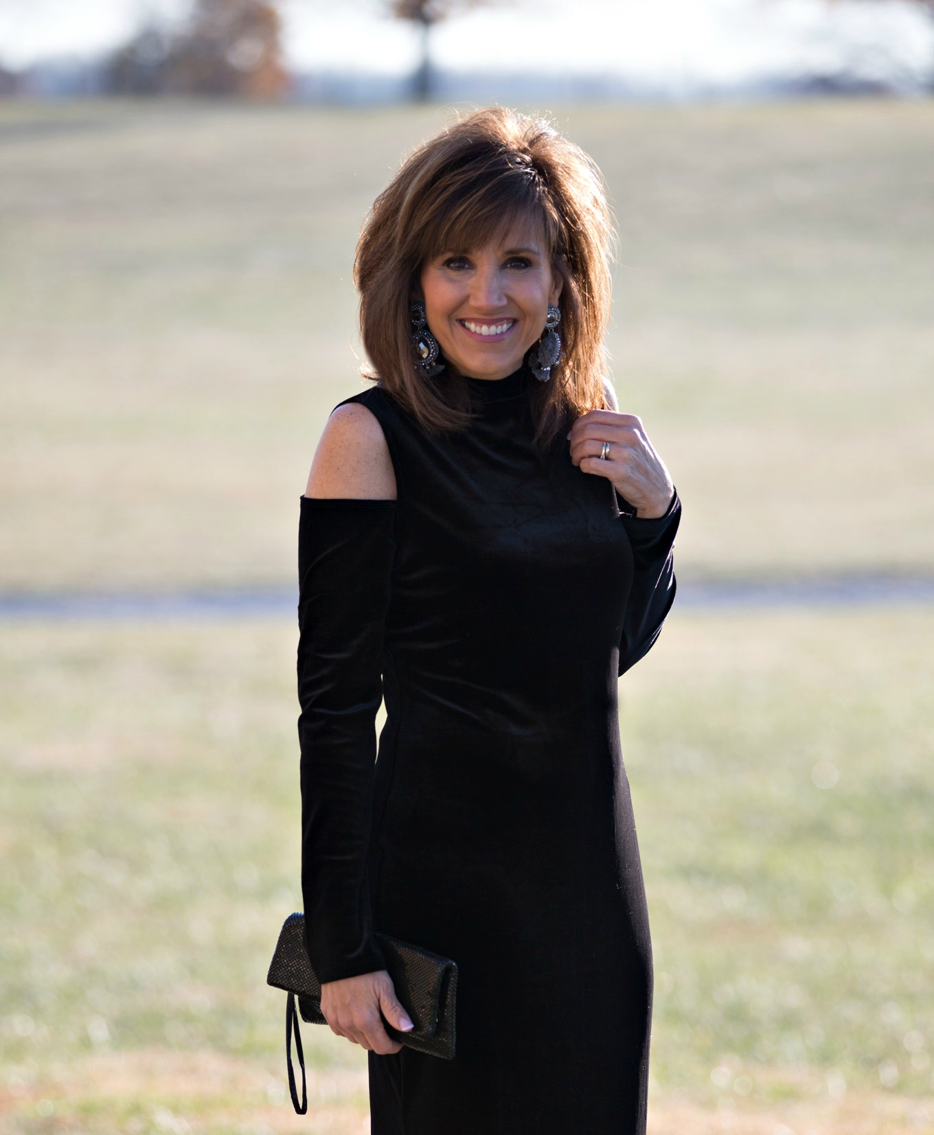 Fashion blogger, Cyndi Spivey, styling a cut out shoulder dress from Nordstrom for holiday style.