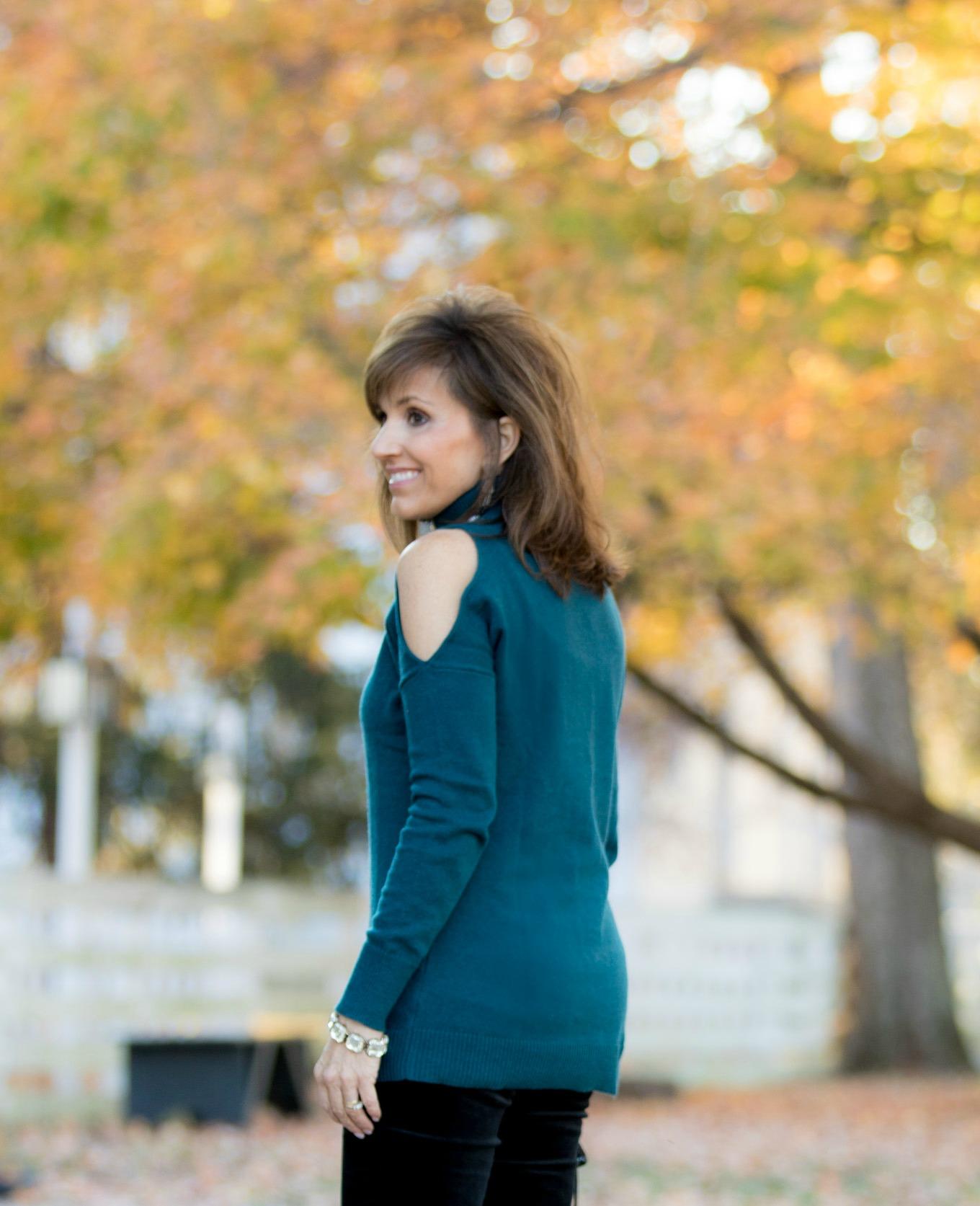 Fashion blogger, Cyndi Spivey, sharing a cold shoulder turtleneck with velvet pants.
