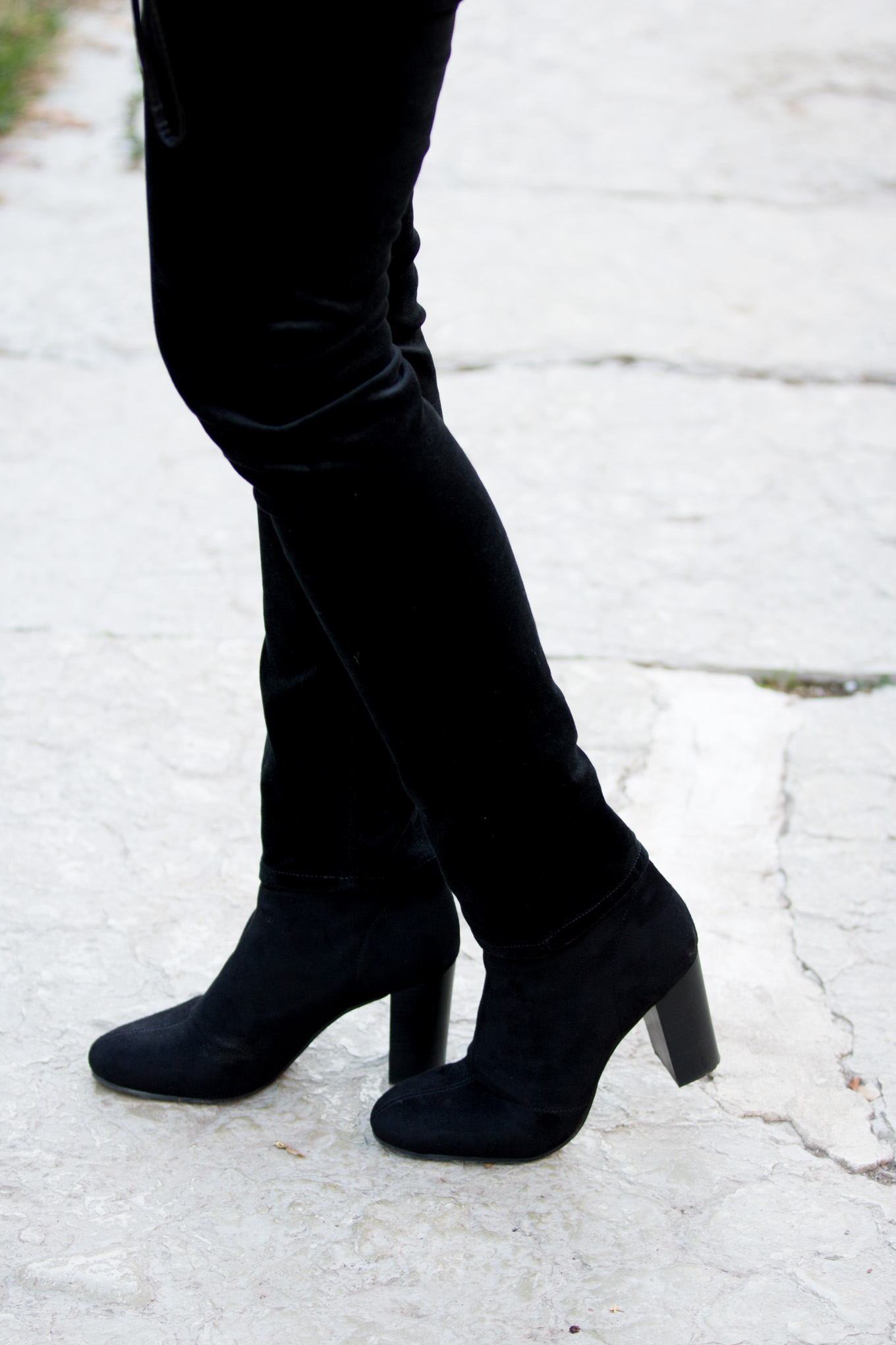 Fashion blogger, Cyndi Spivey, sharing a cold shoulder turtleneck with velvet pants.