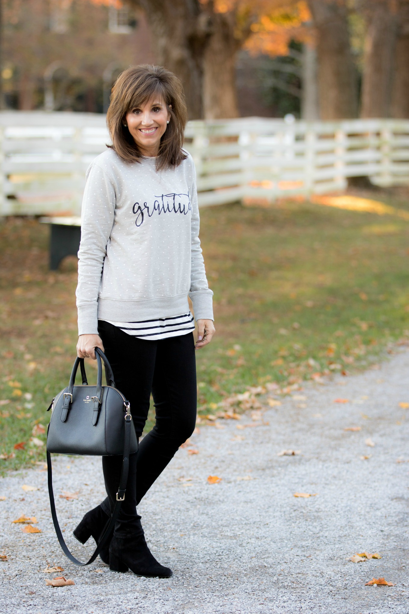 Fashion blogger, Cyndi Spivey, sharing a gratitude sweatshirt from Glamour Farms Boutique.