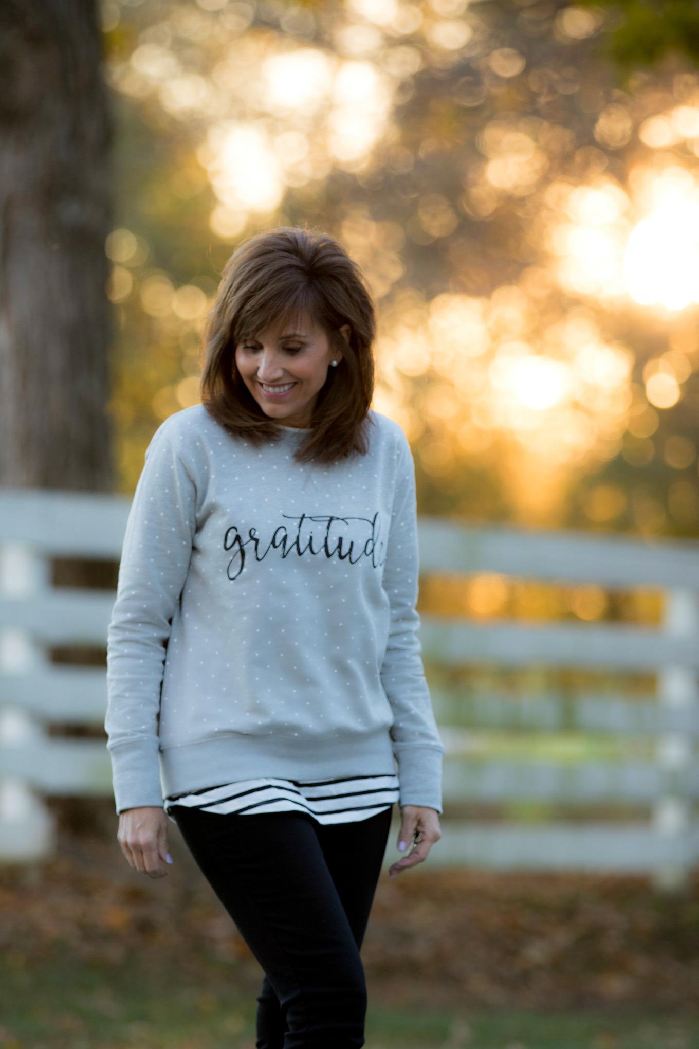 Fashion blogger, Cyndi Spivey, sharing a gratitude sweatshirt from Glamour Farms Boutique.