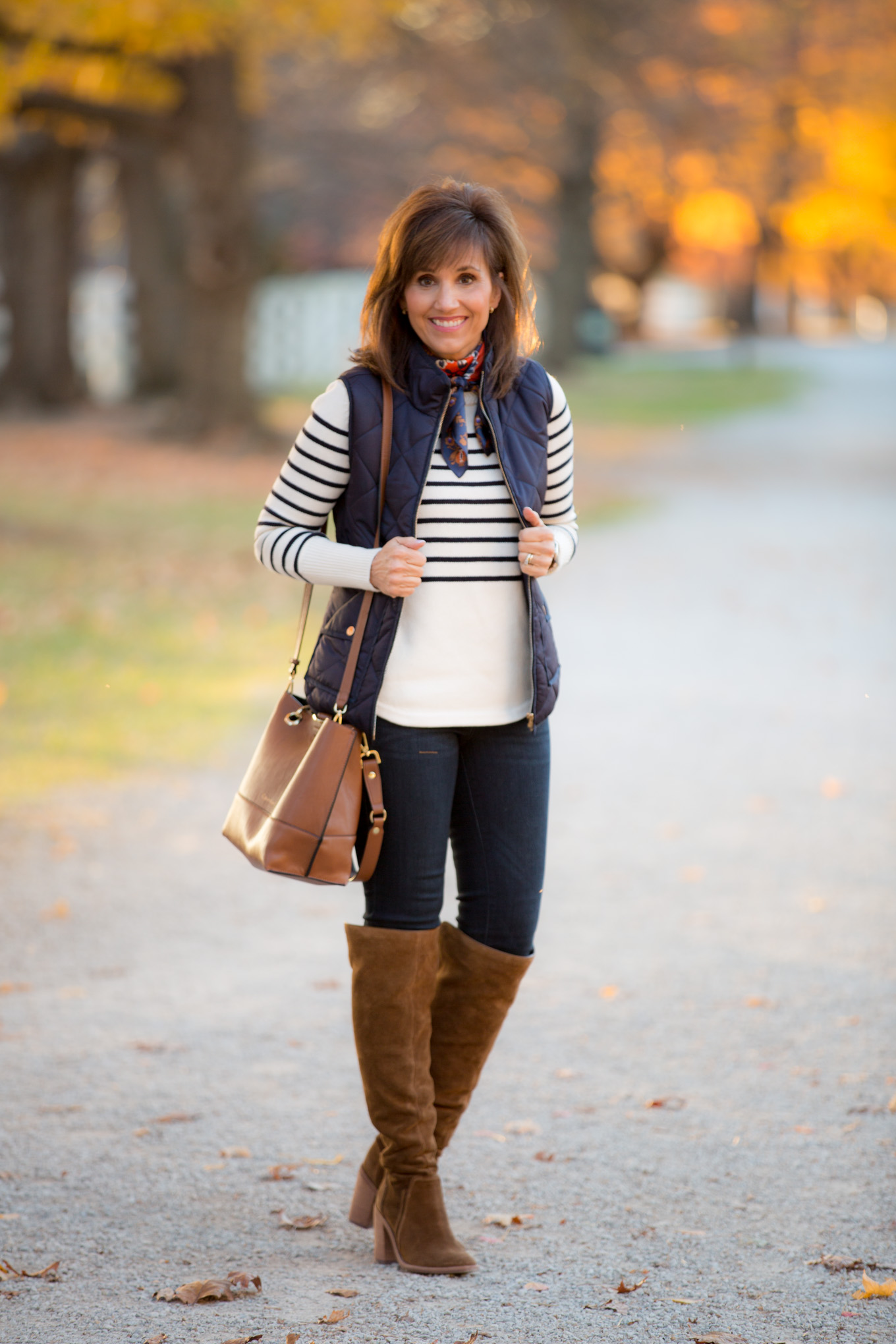 Fashion blogger, Cyndi Spivey, styling the neck scarf trend.