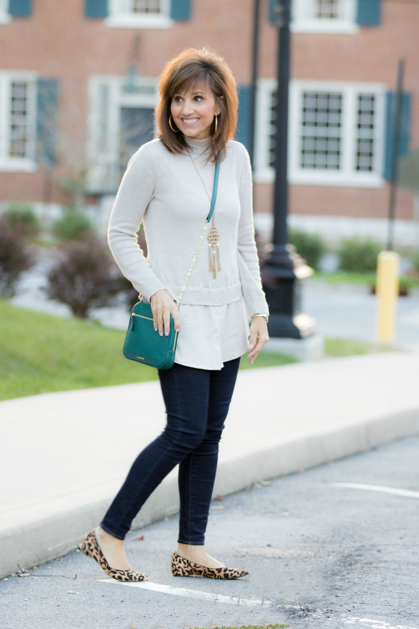 Fashion blogger, Cyndi Spivey, styling a Vera Bradley bag from Macy's.