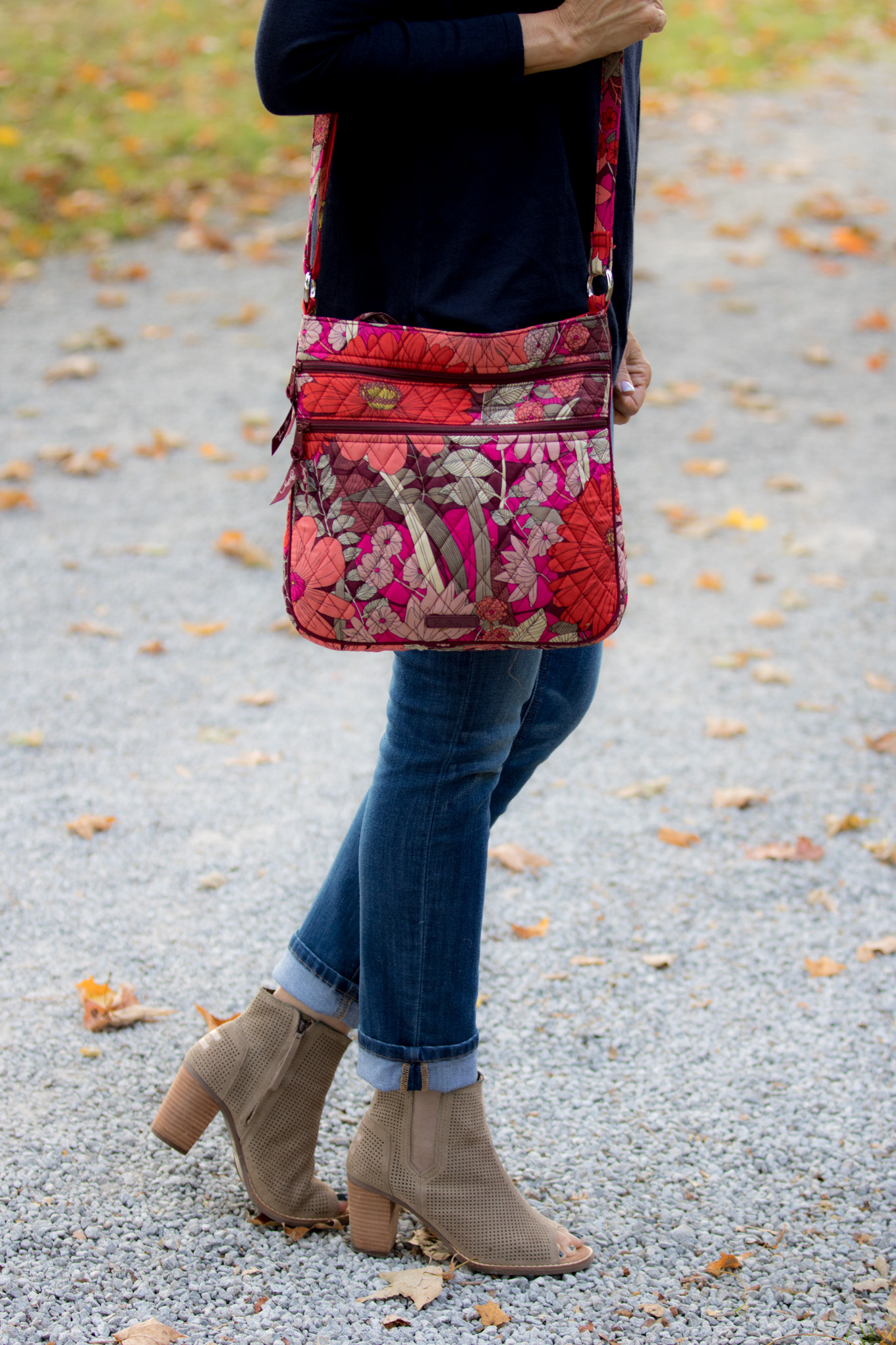 Fashion blogger, Cyndi Spivey, sharing a Vera Bradley crossbody bag.