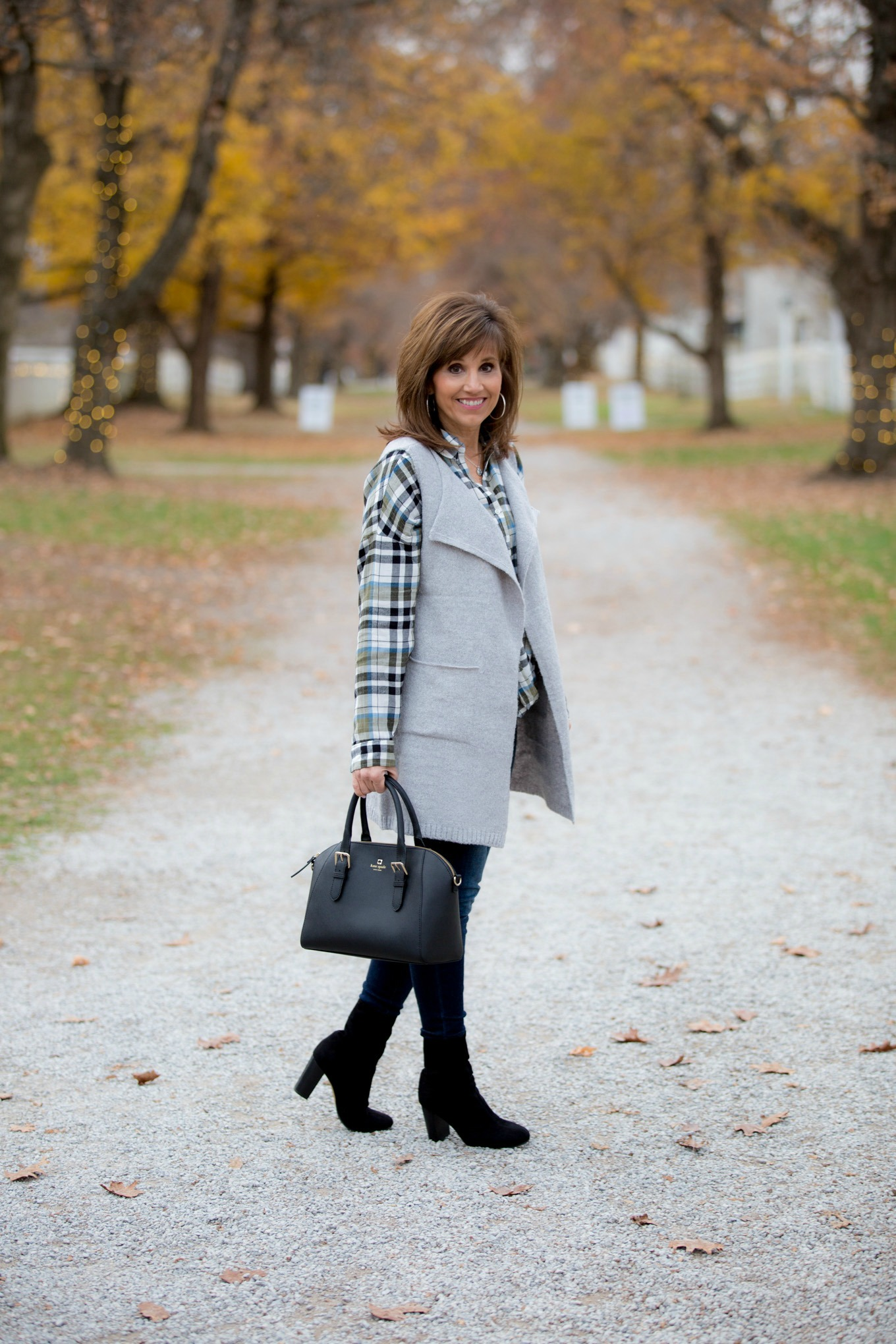 Fashion blogger, Cyndi Spivey, styling a grey vest for Cyber Monday from Glamour Farms.