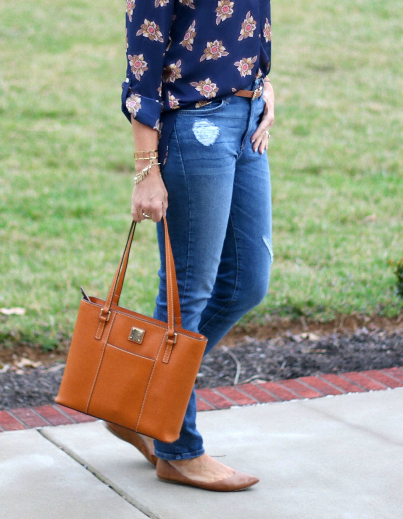 Fashion blogger, Cyndi Spivey, styling a Dooney & Bourke handbag from Macy's.