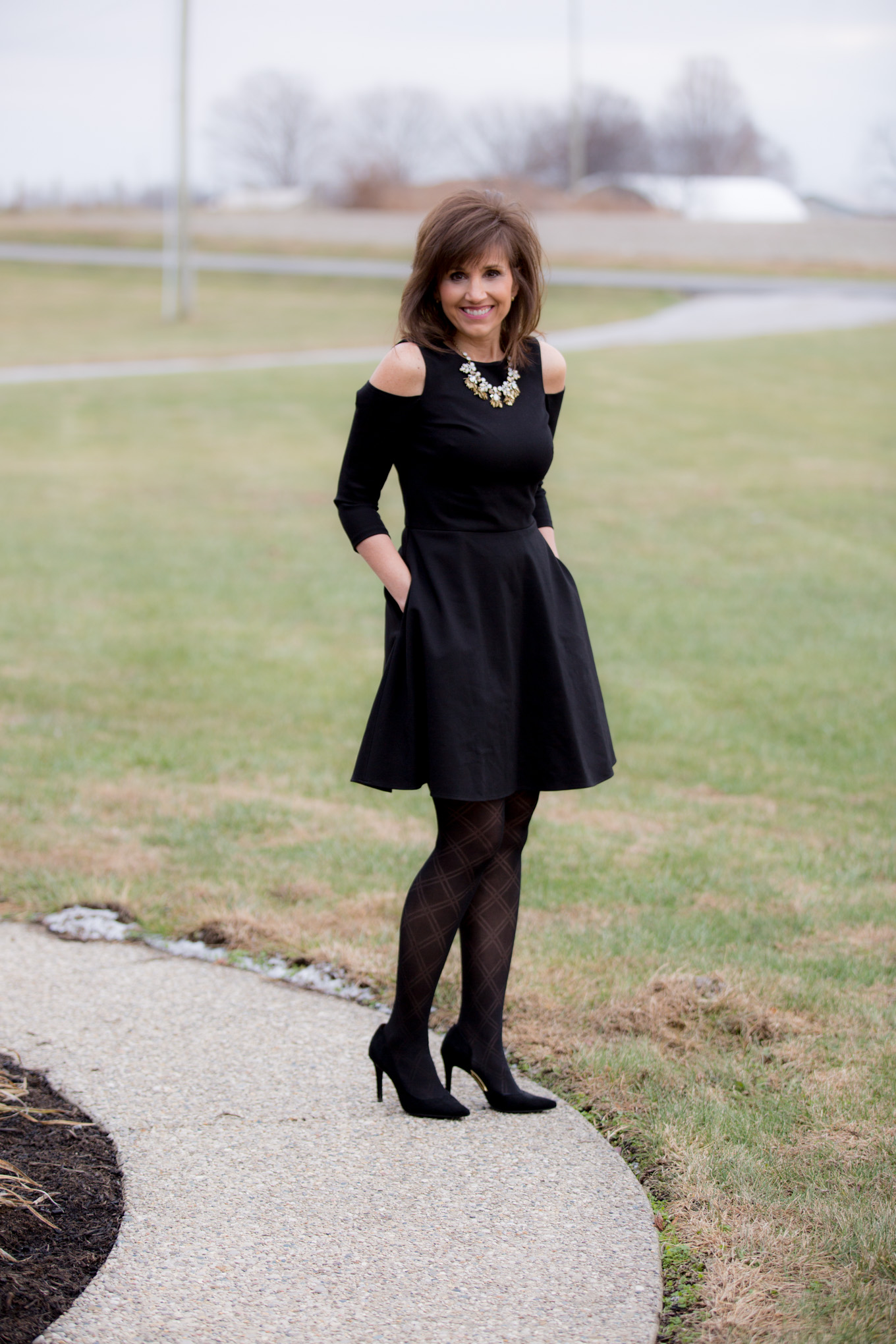 Fashion blogger, Cyndi Spivey, styling a New Year's Eve Outfit.