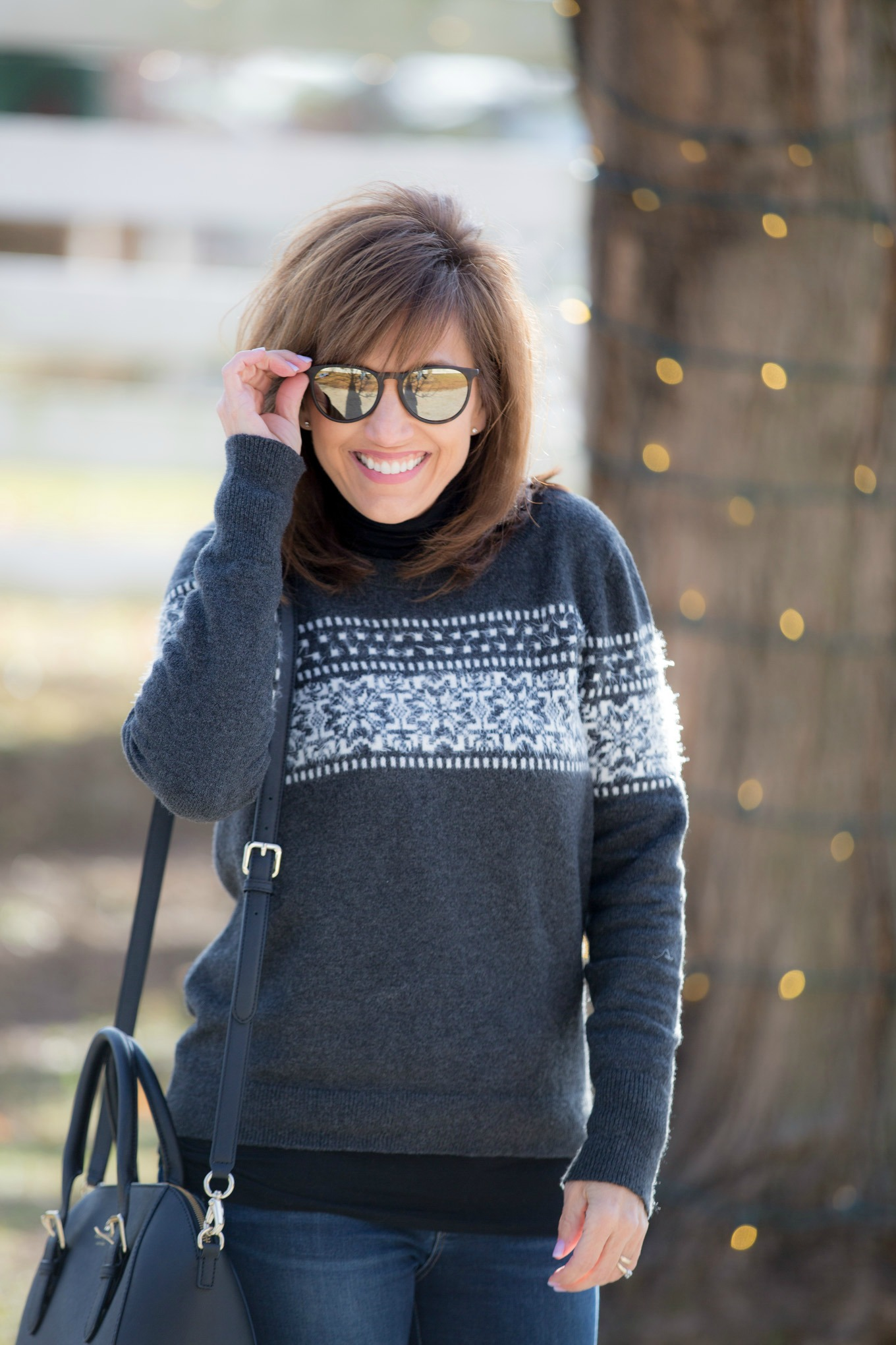 Fashion blogger, Cyndi Spivey, wearing the Erika sunglasses from Ray Ban.