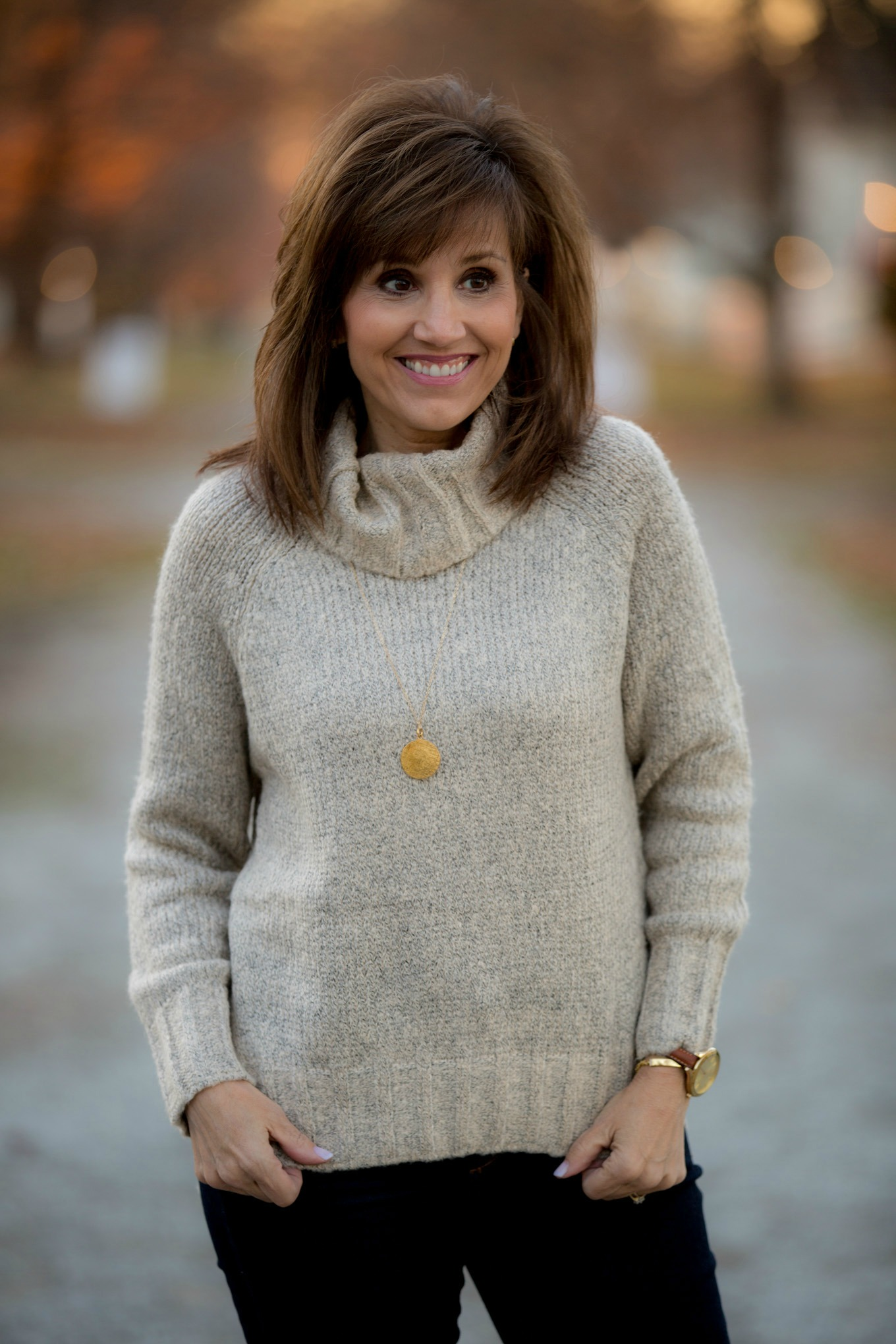 Fashion blogger, Cyndi Spivey, styling a cozy turtleneck sweater for winter fashion.