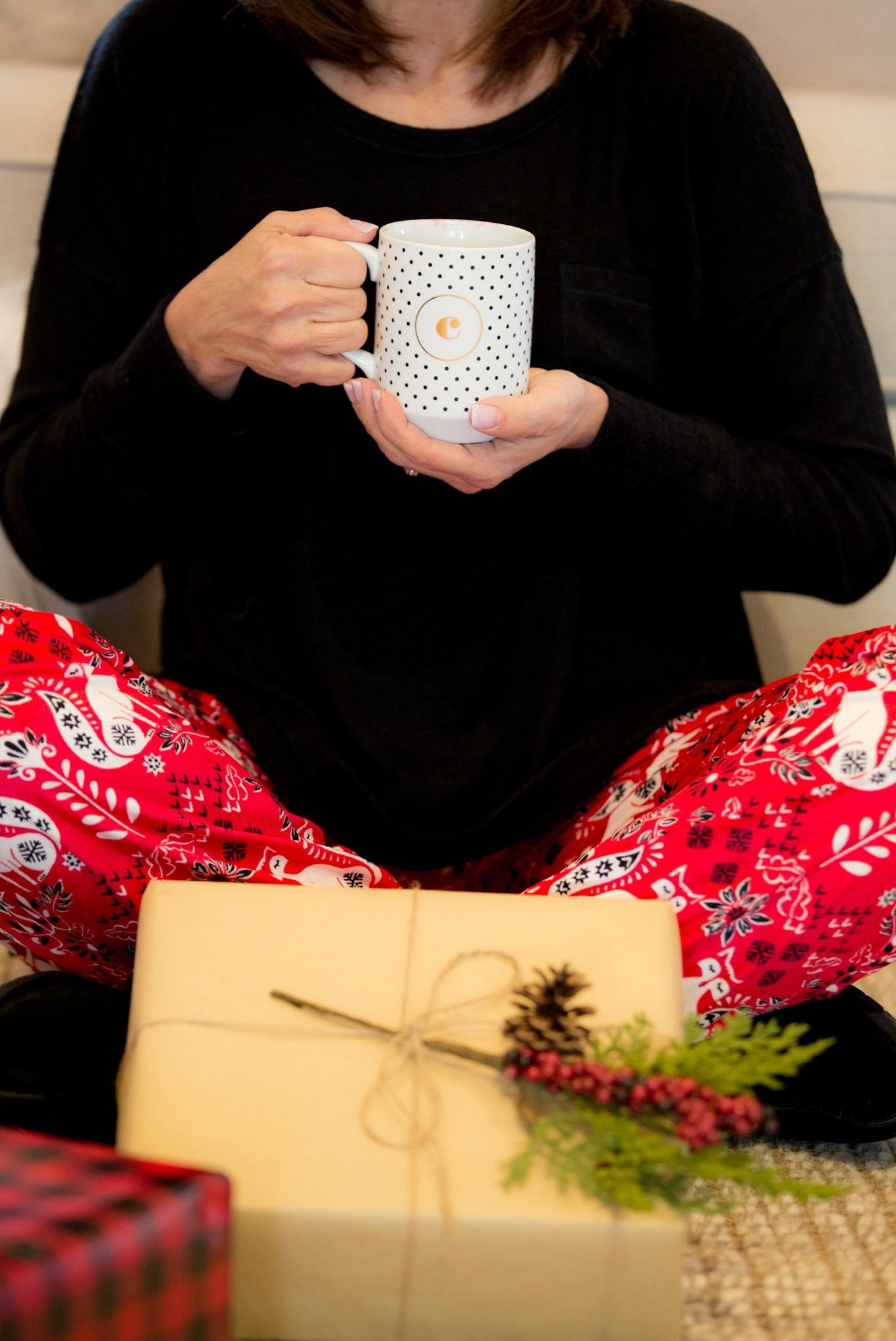 Fashion blogger, Cyndi Spivey, styling Christmas pajamas from Nordstrom.