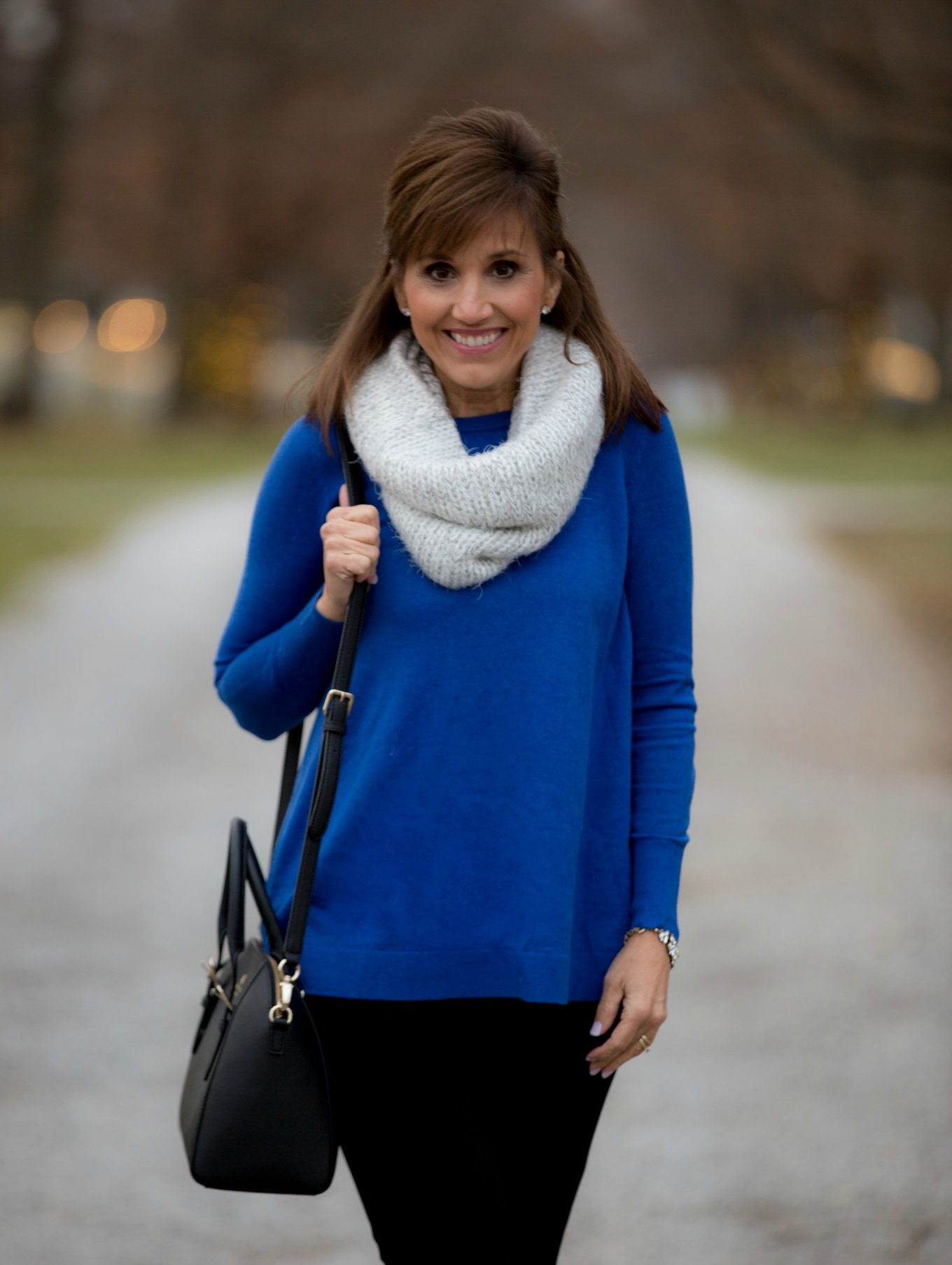 Fashion blogger, Cyndi Spivey, styling a royal blue sweater from Loft.