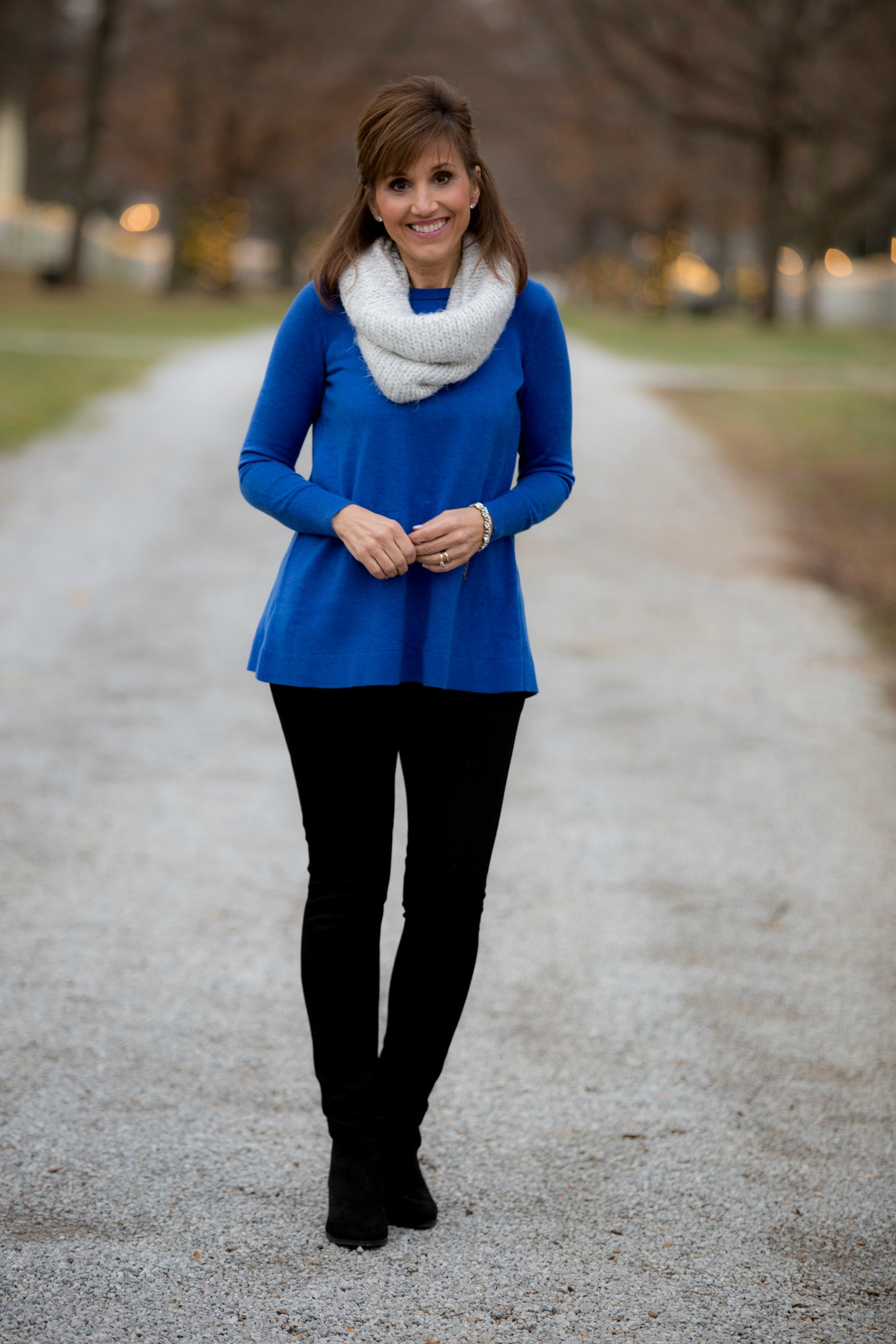 Fashion blogger, Cyndi Spivey, styling a royal blue sweater from Loft.