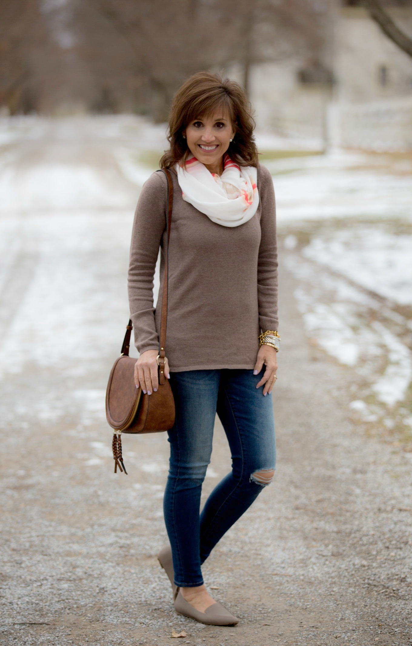Over 40 fashion blogger, Cyndi Spivey, styling a casual winter outfit.
