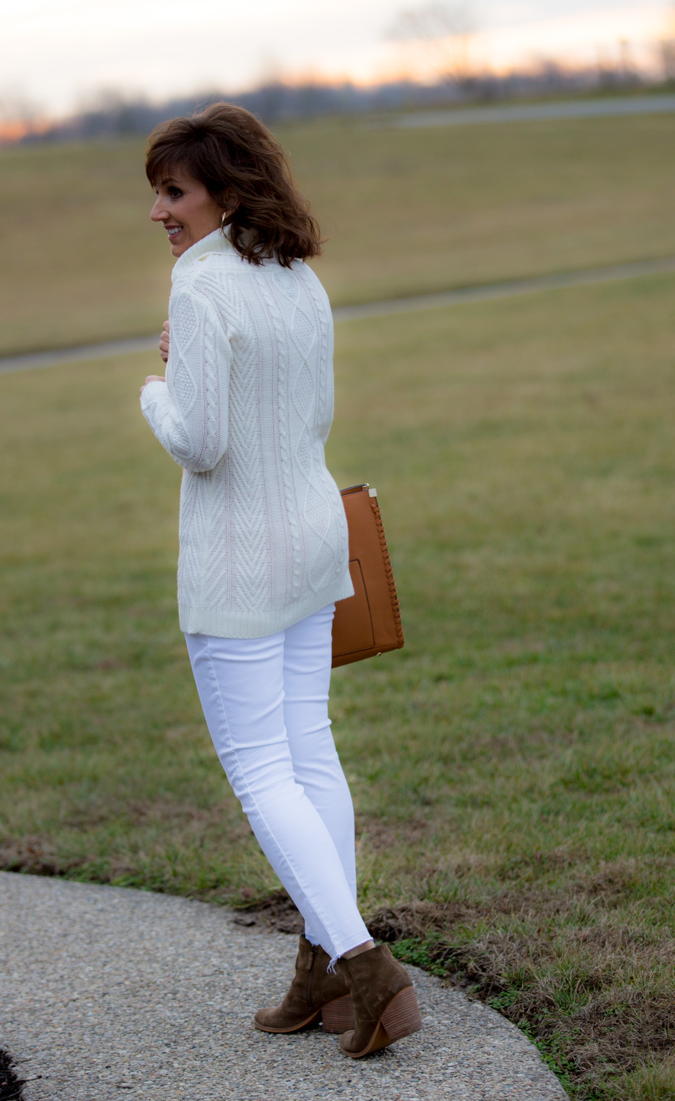 Fashion blogger, Cyndi Spivey, styling a casual cowl neck sweater.