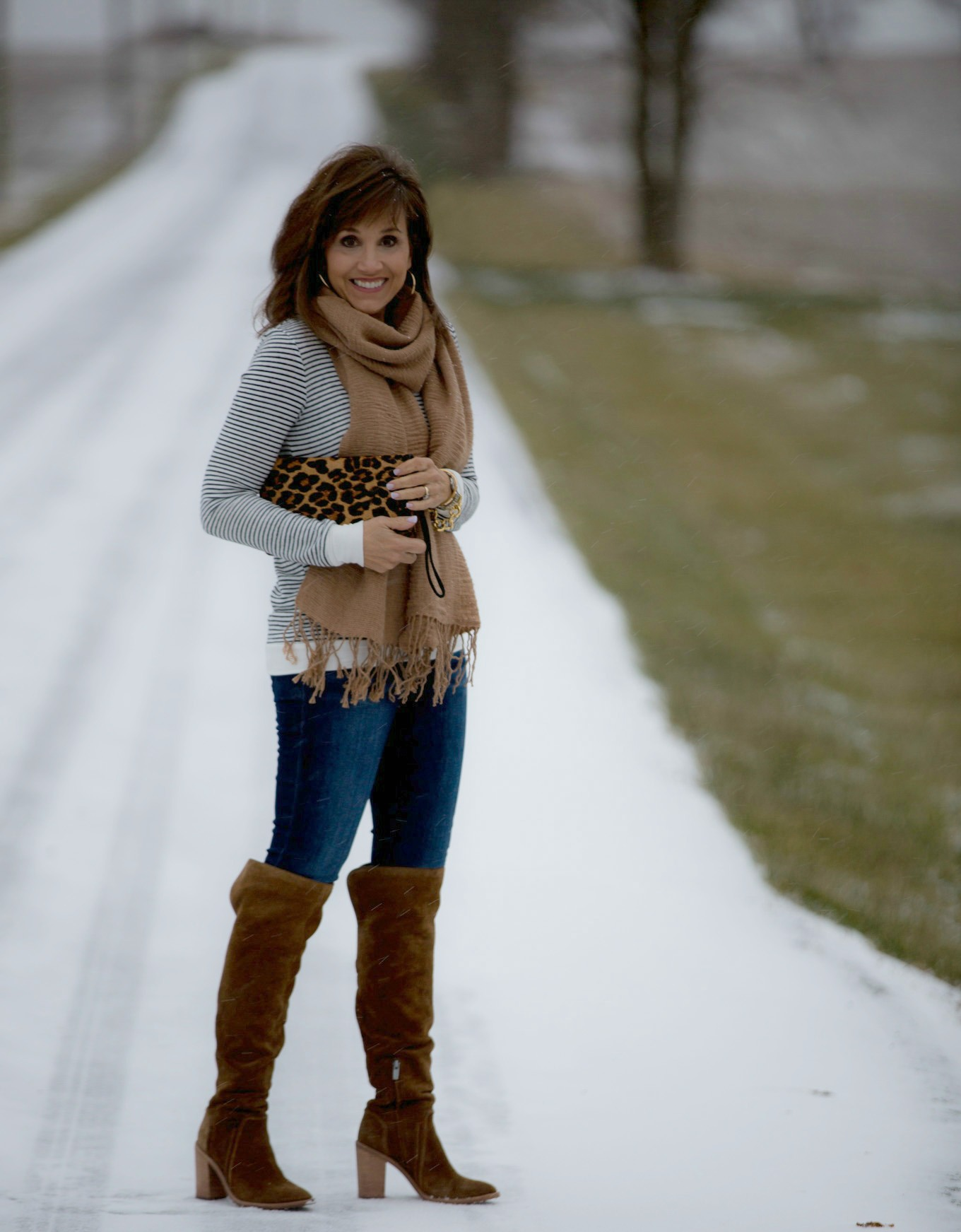 Fashion blogger, Cyndi Spivey, styling a striped top and fringe scarf.